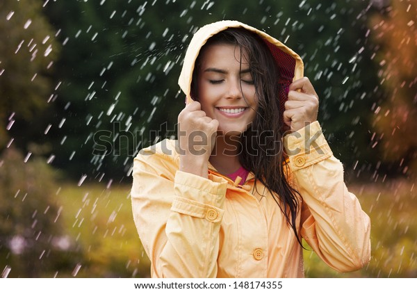 Natural female beauty in autumn rain