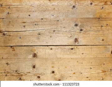 Natural fir wood texture with cracks and knots