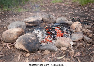 Natural firepit for camp cooking