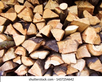 Natural firewood for the fireplace. Wood texture for background
