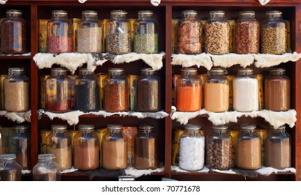 Natural food items and medical herbs in glass containers - asian marketplace