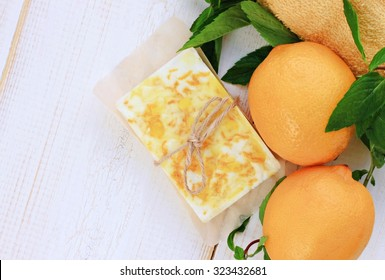 Natural fresh fruit soap, organic skin care product, handcrafted, lemon mint, setting, empty background