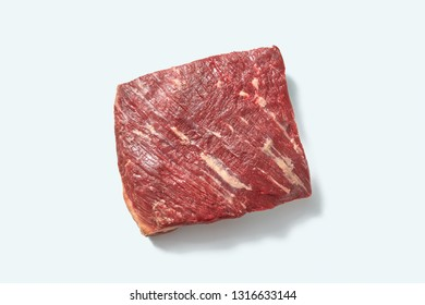 Natural fresh organicraw veal for cooking with shadows on a white background, place for text. Top view.