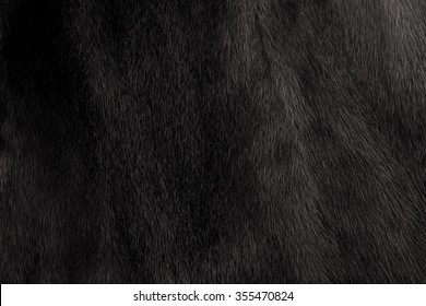 Natural fur mink black. Close-up, texture