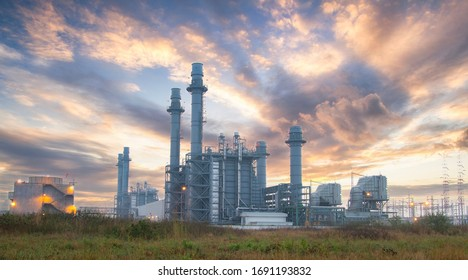 Natural Gas Combined Cycle Power Plant with sunset and light orange