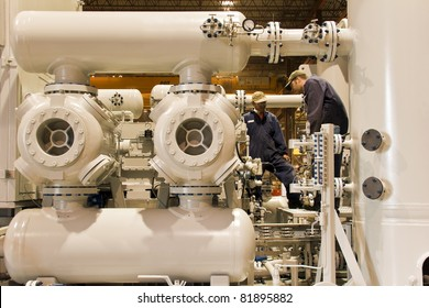 Natural gas compressor station  with two working technicians