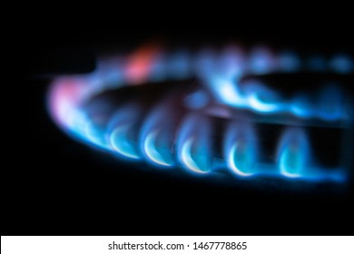 Natural gas. Fire natural gas burner in home on a dark background