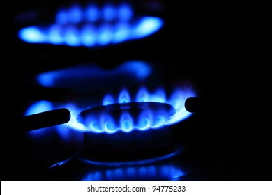 Natural gas flame. Flames of gas stove in the dark