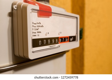 Natural gas meter counter closeup. Background with copy space.