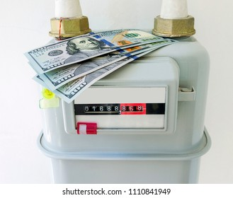 Natural gas meter with US dollars banknotes at home. Symbolic image for heating costs, increased gas prices.