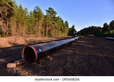 Natural gas pipeline construction. Out of focus, possible granularity, motion blur