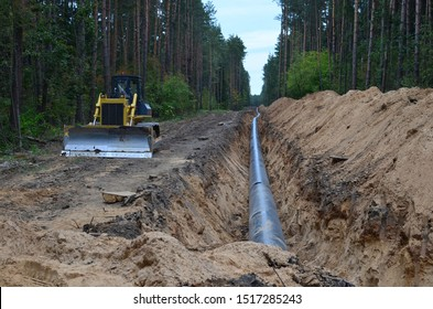 Natural gas pipeline construction work. A dug trench in the ground for the installation and installation of industrial gas and oil pipes. Underground work project. Small sharpness, granularity