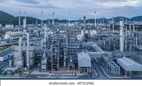 Natural gas storage tanks and oil tanks in oil refinery plant at industrial zone.