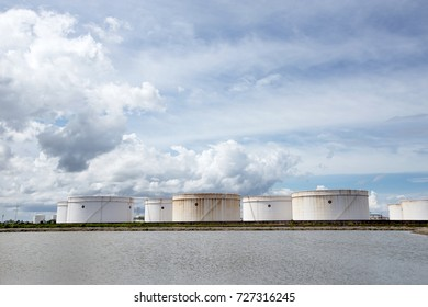 Natural Gas storage tanks and oil tank in industrial factory plant. Oil Storage tanks at harbor under cloudy sky