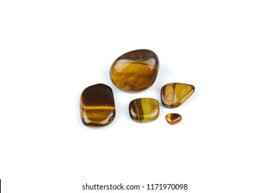 Natural gem stones ( Tiger eye ) isolated on white background.