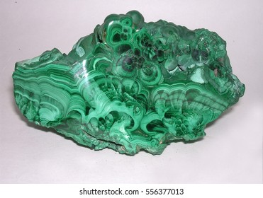 natural gemstone malachite closeup on white background