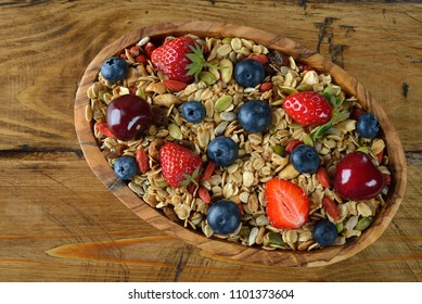 Natural granola with fruit on a brown background