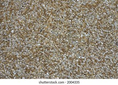 Natural gravel sidewalk closeup in Bordeaux, France
