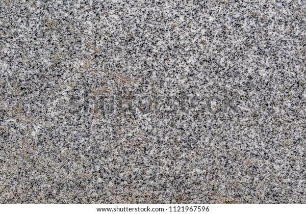 Natural gray polished granite texture.