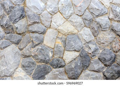 Natural grey stone wall, concept for background texture.