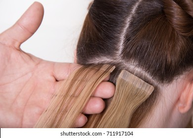 Natural Hair extensions at salon, closeup hands in hair
