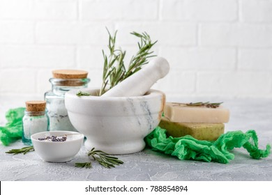 Natural handmade soap with rosemary, sea salt, essential and massage oil and rosemary twigs. Healthy skin care. SPA concept.
