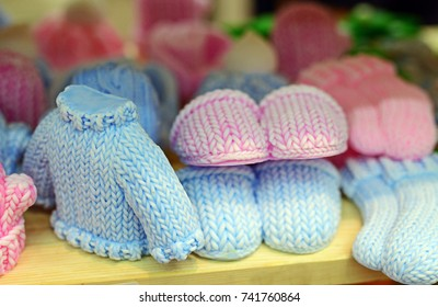 Natural handmade soaps in the form of sweater and slippers