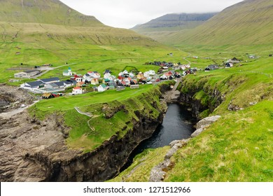 Natural harbour gorge nearby idyllic village Gjogv, most northern village of Eysturoy, Faroe islands