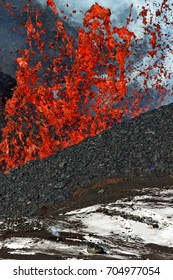 Natural hazard landscape: beautiful eruption volcano on Kamchatka Peninsula - red hot lava fountain, erupting from crater active Tolbachik Volcano. Russian Far East, Klyuchevskaya Group of Volcanoes.