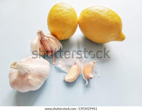 Natural healing, alternative medicine with Lemon and Garlic. Healthy ingredients for strengthening immunity. Food rich in vitamin C, vitamin A, vitamin B, selenium, calcium, iodine, etc.