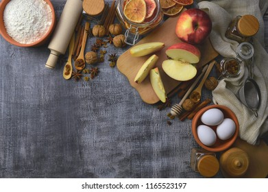 Natural healthy products. Cooking. Bakery products. Organic rural products on a wooden background and kitchen tools, top view. The concept of proper nutrition. Home cosiness.