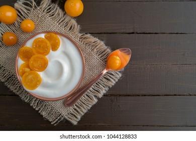 Natural healthy yogurt with muesli and fruit.