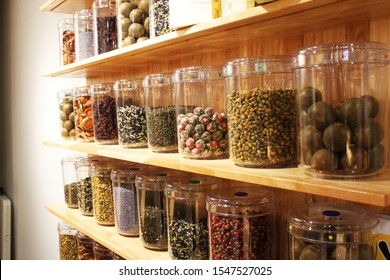 Natural herbal medicine sets selected in a variety of jars The background on the wooden cabinet Arranged in an orderly way