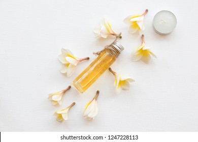 natural herbal oils from flower frangipani smells scents aroma on background white
