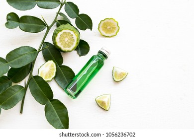 natural herbal oils from kaffir lime smell scents aroma on background white