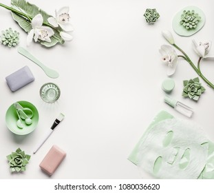 Natural herbal skin care cosmetic setting with accessories and facial calming sheet mask on white background, top view, frame, flat lay