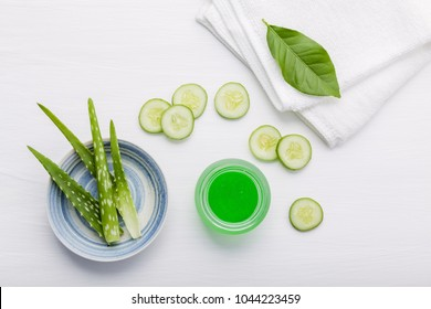 Natural herbal skin care products. Top view ingredients cucumber and aloe vera on table concept of the best all natural face moisturizer. Facial treatment preparation background.