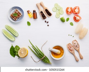 Natural herbal skin care products. Top view ingredients cucumber, aloe vera, lemon, honey, himalayan salt and tomato on table concept natural face moisturizer. Facial treatment preparation background.
