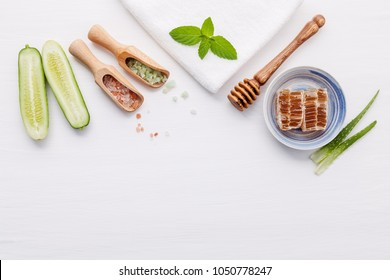 Natural herbal skin care products. Top view ingredients cucumber and aloe vera gel on table concept of the best all natural face moisturizer. Facial treatment preparation background.