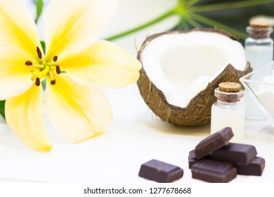 Natural herbal skin care products, top view ingredients coconut, chocalate on table concept of the best all natural face moisturizer. Facial treatment preparation background