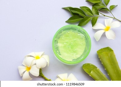 natural herbal soothing gel from aloe vera for skin face on background white