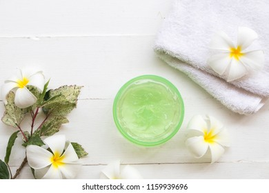 natural herbal soothing gel aloe vera with towel for beauty skin face health care of woman on background white
