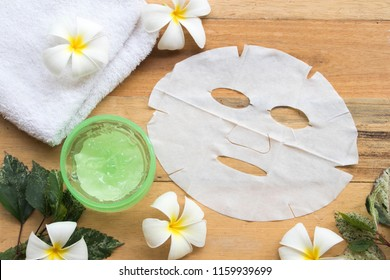 natural herbal soothing gel aloe vera with nature sheet mask for beauty skin face health care of woman on background wooden