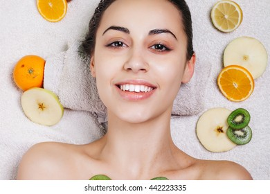 Natural homemade fruit facial masks. Fresh fruit. close-up portrait. beautiful brunette girl with no makeup, natural makeup
