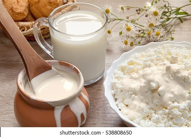 Natural homemade milk, sour cream, fresh curd. Healthy breakfast in a rustic style. Dairy.