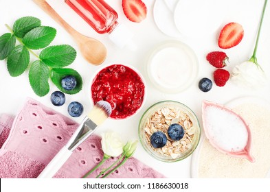 Natural homemade skin care with fresh berries, yogurt, oat flakes for body scrub, cosmetic products cleansing and anti aging, bright fruit ingredients.
