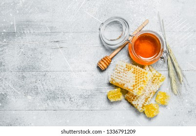 Natural honey in honeycombs. On a rustic background.