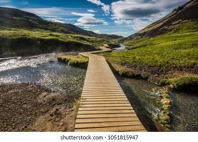 Natural hot spring area Reykjadalur with wooden bridge, Iceland