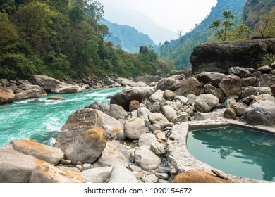 Natural hot spring in the Himalayas on a spring day, Nepal.