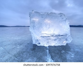 Natural ice blocks. Ice floe breaking due to strong wind against the shore and move. Freezing winter weather.